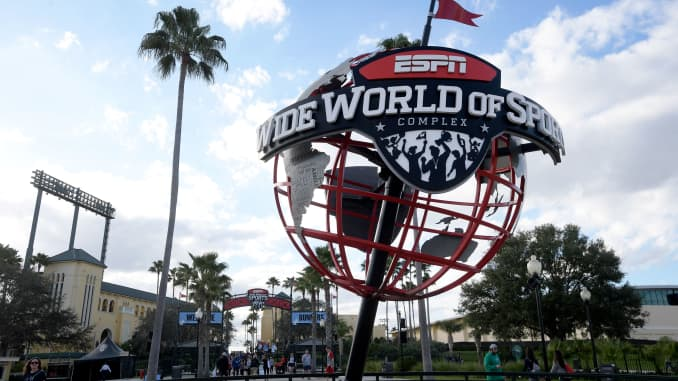 A globe stands at the entrance to the ESPN Wide World of Sports complex in Lake Buena Vista, Fla.