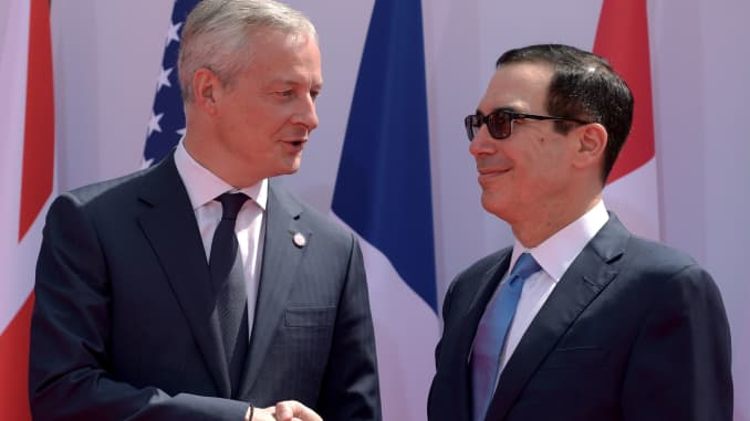French Finance and Economy Minister Bruno Le Maire (L) greets US Treasury Secretary of State Steven Mnuchin.