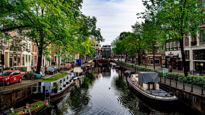 Amsterdam's canals empty and deserted during the government imposed quarantine due to the coronavirus pandemic.