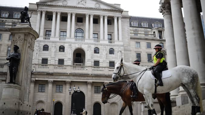 Mounted police officers sit in outside the Royal Exchange and the Bank of England in London on June 17, 2020.