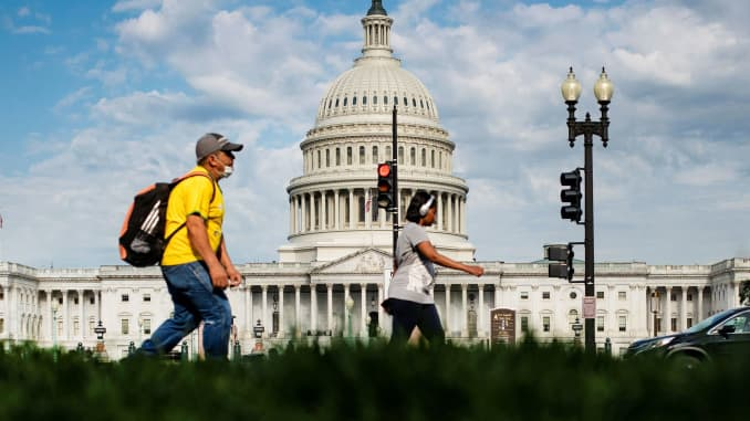 A man walks past the U.S. Capitol building in Washington, June 25, 2020.