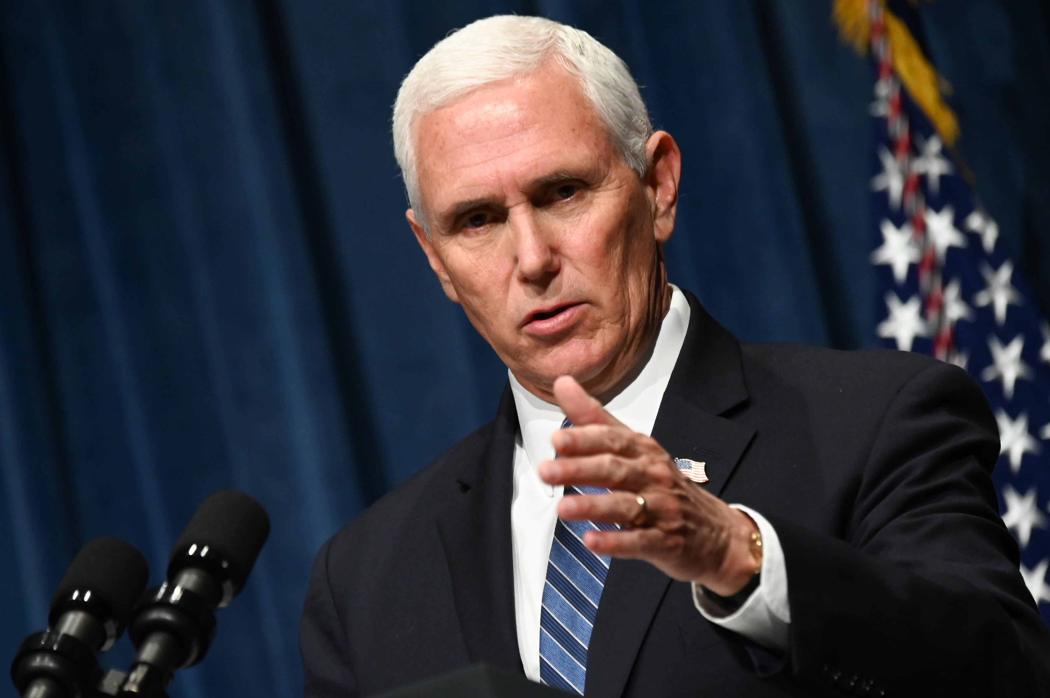Pence vows to `keep opening up America` as...