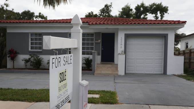 A for sale sign is seen in front of a home as the National Association of Realtors released a report showing that home sales dropped in December of 2017 on January 24, 2018 in Miami, Florida.