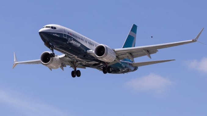 A Boeing 737 MAX airplane lands after a test flight at Boeing Field in Seattle, Washington, U.S. June 29, 2020.