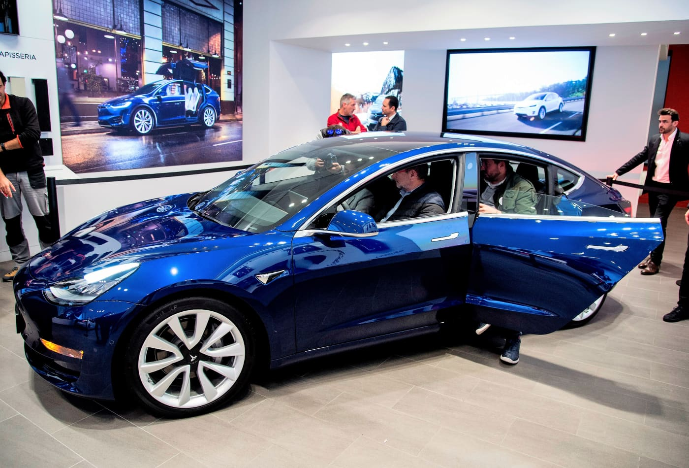 Here's what buying $55,000 worth of Tesla stock teaches us about the hidden cost of big investments