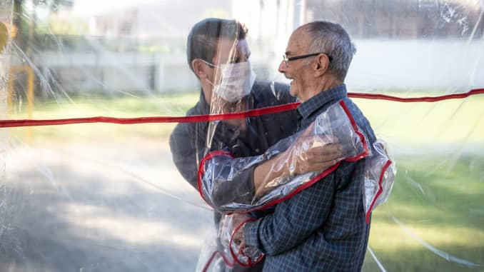 A son hugs his father at the Geriatric Clinic Três Figueiras on June 16, 2020 in Gravatai, Brazil. The clinic created the Tunel do Abraco (hug tunnel) for elderly residents to be able to hug relatives after more than 70 days apart due to the coronavirus pandemic. The tunnel is made of a thick plastic curtain with sleeves, which guarantees the safety of families. After each use, the environment is cleaned by a clinic professional.