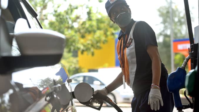 Indian oil petrol pump staff wearing and gloves as as a preventive measure against the spread of coronavirus (Covid-19) near Jor Bagh on March 18, 2020 in New Delhi, India.
