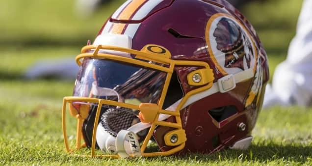 FedEx, which paid $205 million to name the Washington Redskins' stadium, asks team to change name