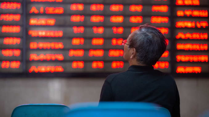 A shareholder watches the stock market in a securities business hall. Nanjing, Jiangsu Province, China, 6 July 2020.