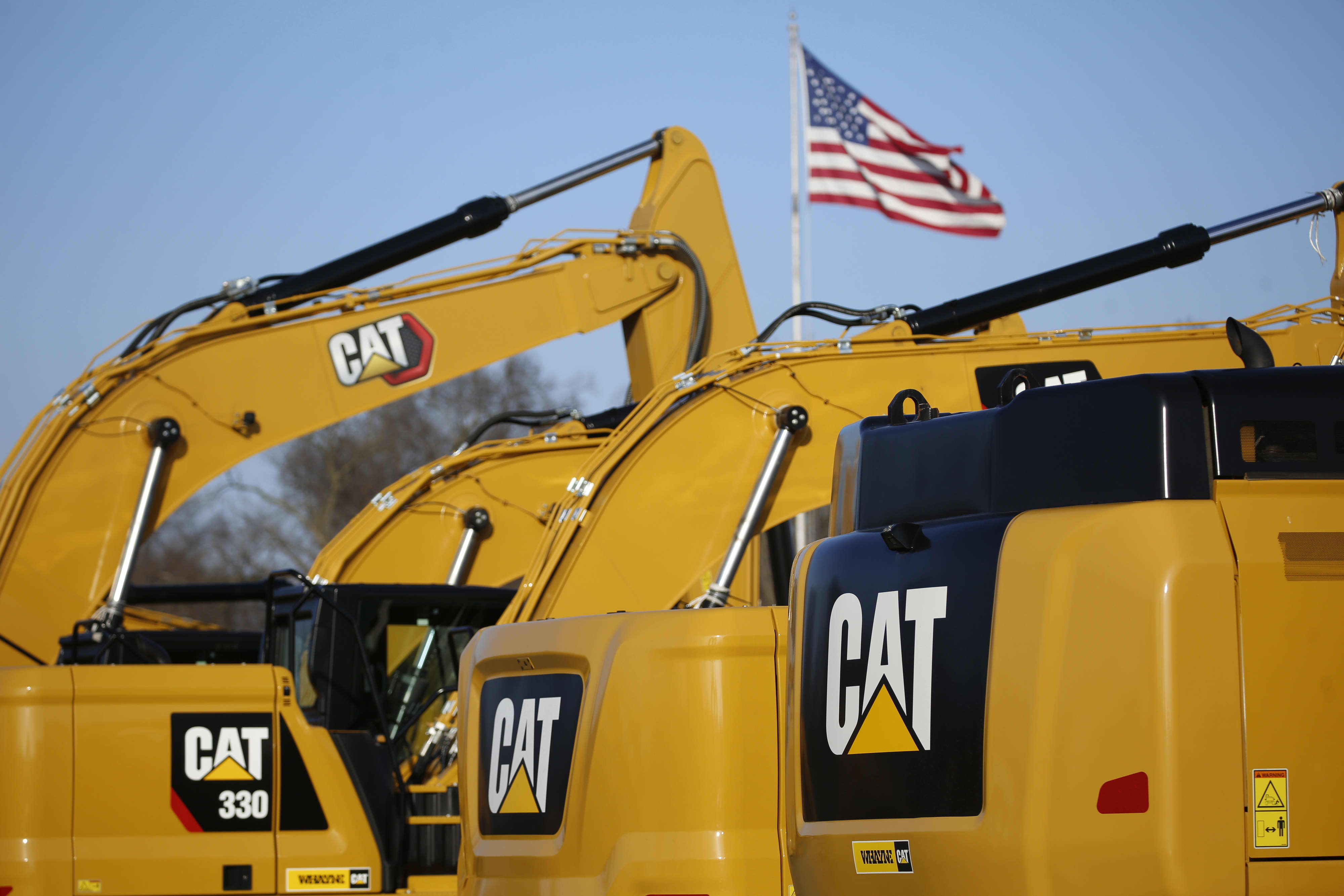 Shares of Caterpillar jump after the Dow component reports better-than-expected results