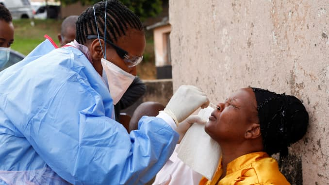 A health worker wearing a protective suit takes a swab from a resident during a door-to-door testing in an attempt to contain the coronavirus disease (COVID-19) outbreak, in Umlazi township near Durban, South Africa, April 4, 2020.