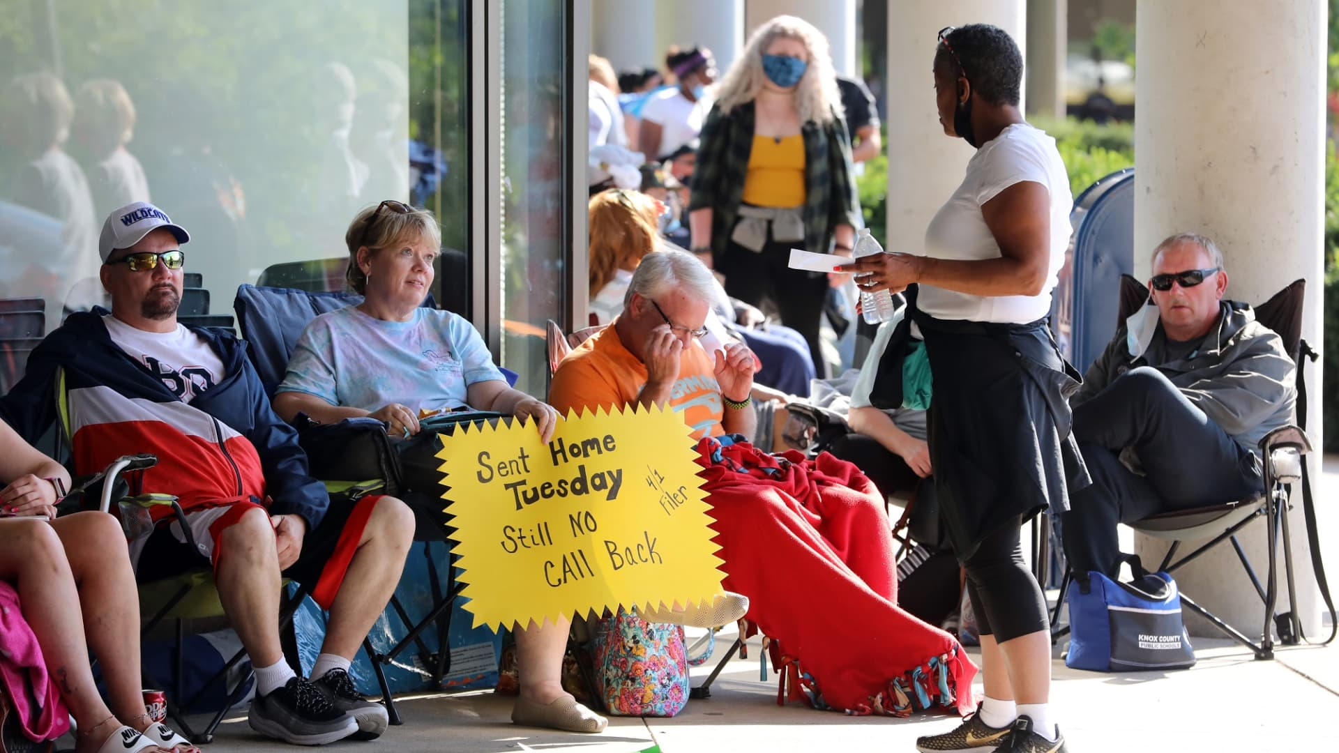 Hundreds of unemployed Kentucky residents wait in long lines outside the Kentucky Career Center for help with their unemployment claims on June 19, 2020 in Frankfort, Kentucky.