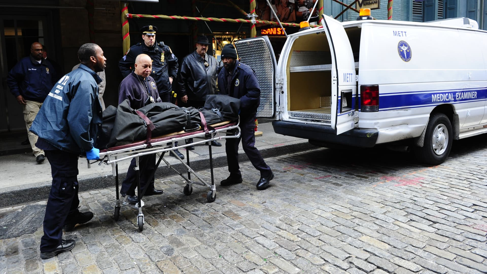 Medical examiners remove the body of Mark Madoff from his New York apartment on Dec. 11, 2010.