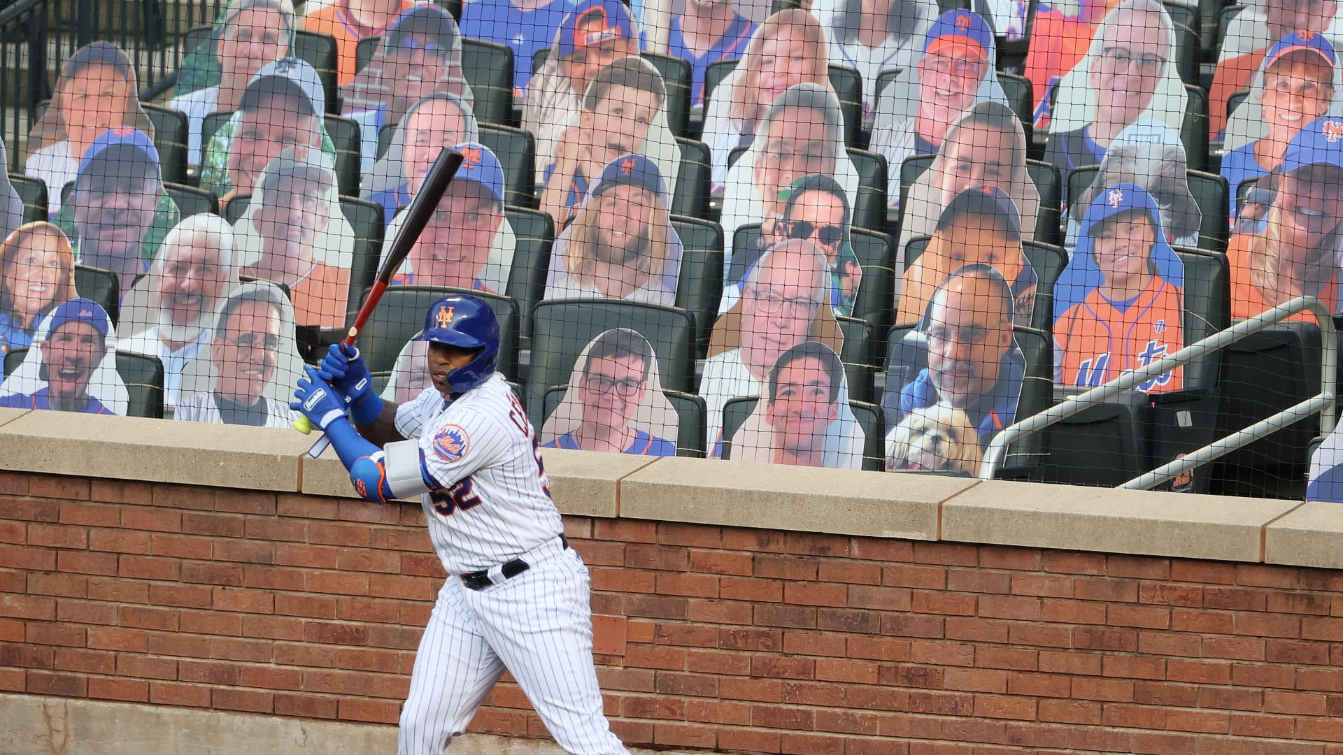 Yoenis Cespedes #52 of the New York Mets stands in the on deck circle in front of cardboard fans during their Pre Season game at Citi Field on July 18, 2020 in New York City.