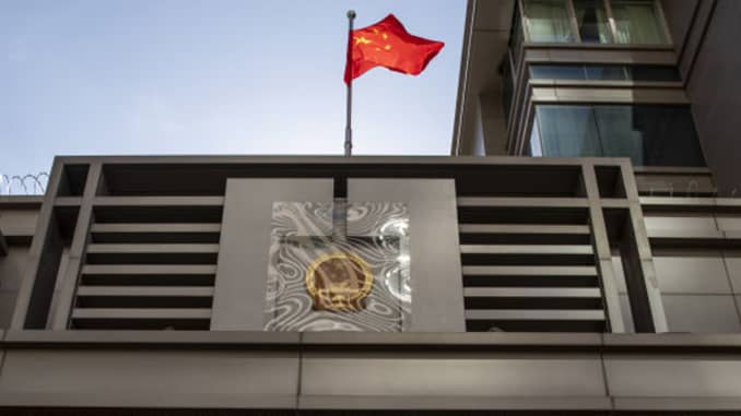 The Chinese flag stands on display outside the China Consulate General building in Houston, Texas, U.S., on Wednesday, July 22, 2020.