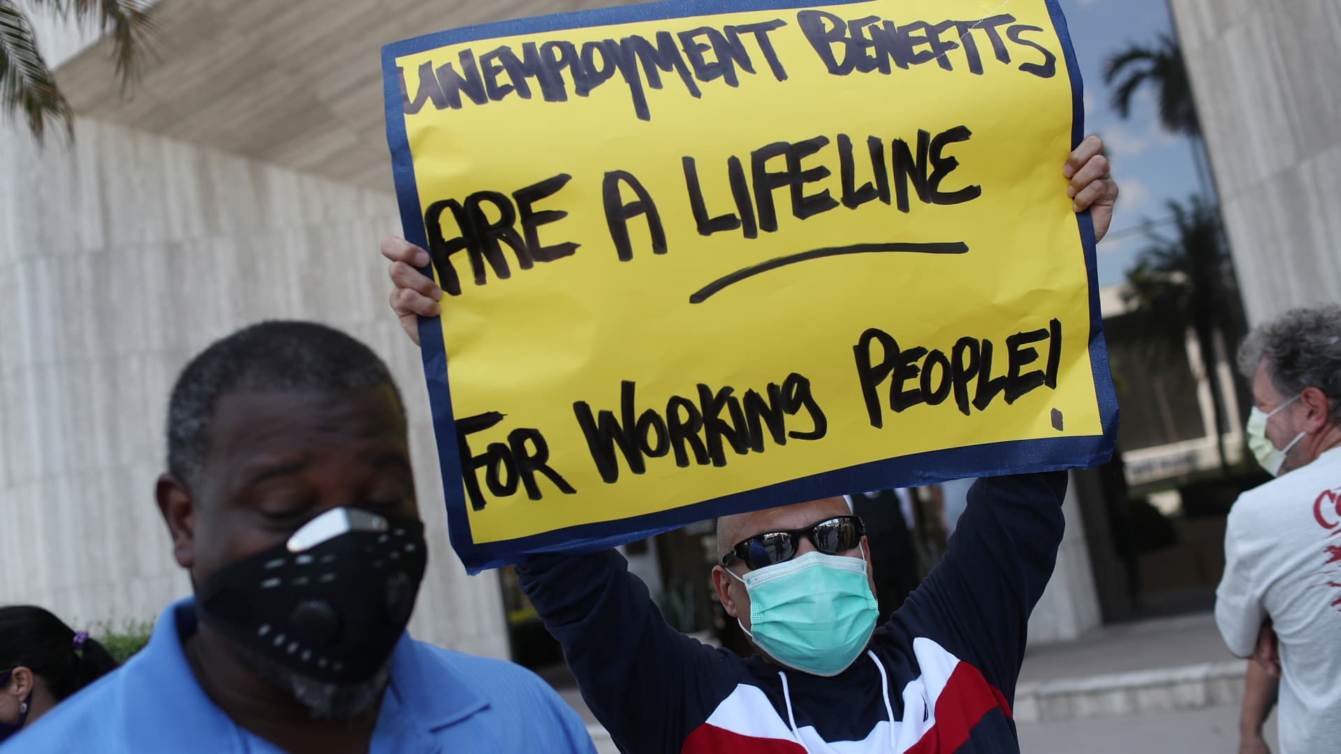 Demonstrators participate in a protest asking senators to support the continuation of unemployment benefits on July 16, 2020 in Miami Springs, Florida.