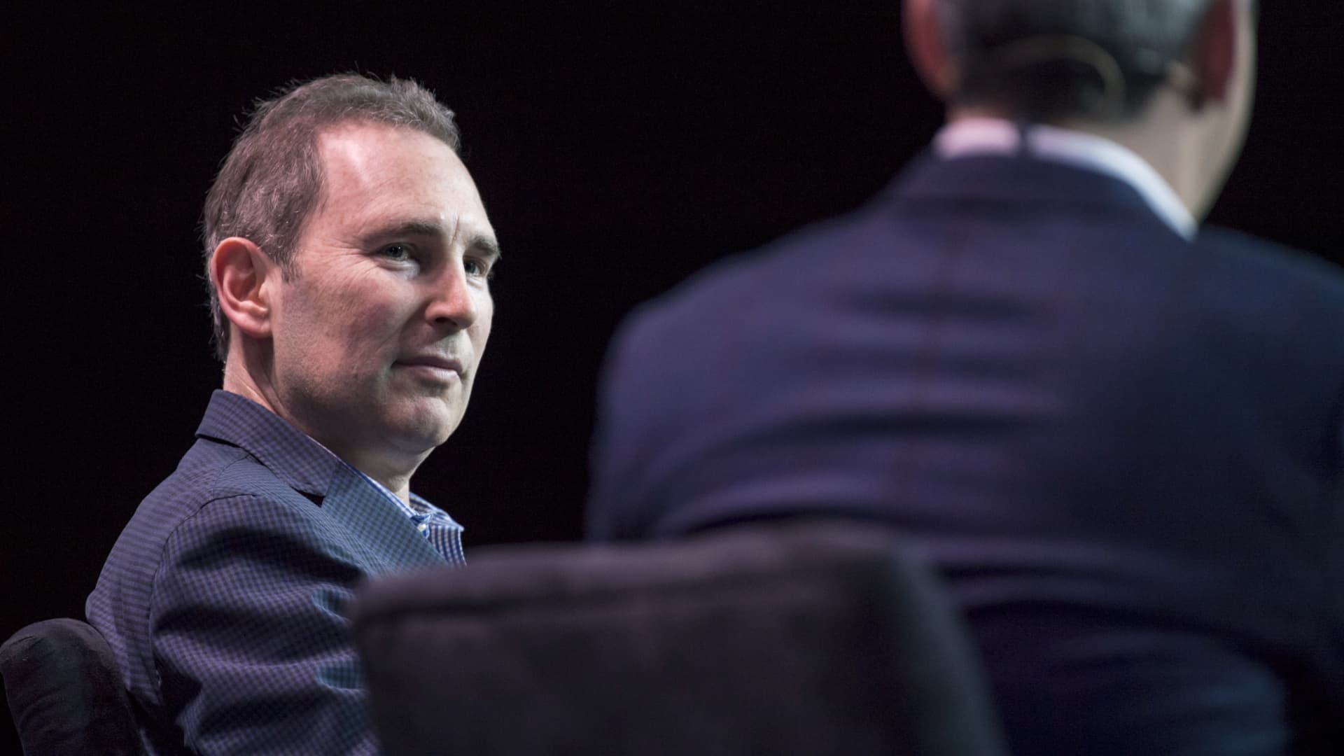 Andy Jassy, chief executive officer of web services at Amazon.com Inc., listens during the Amazon Web Services Summit in San Francisco on April 19, 2017.