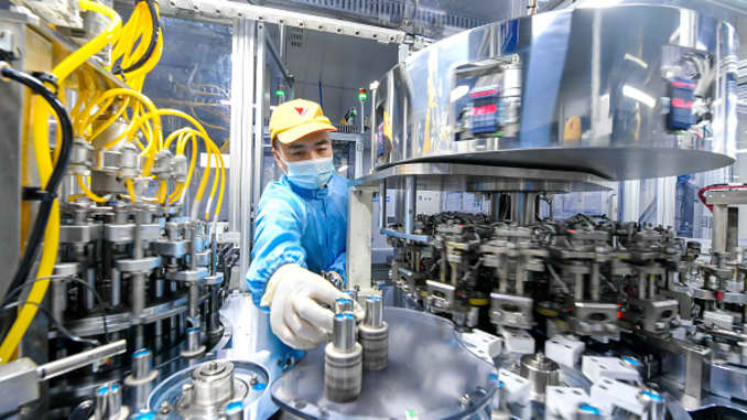 An employee works on the production line of lithium battery at a factory of Tianneng Battery Group Co., Ltd on July 20, 2020 in Changxing County, Zhejiang Province of China.