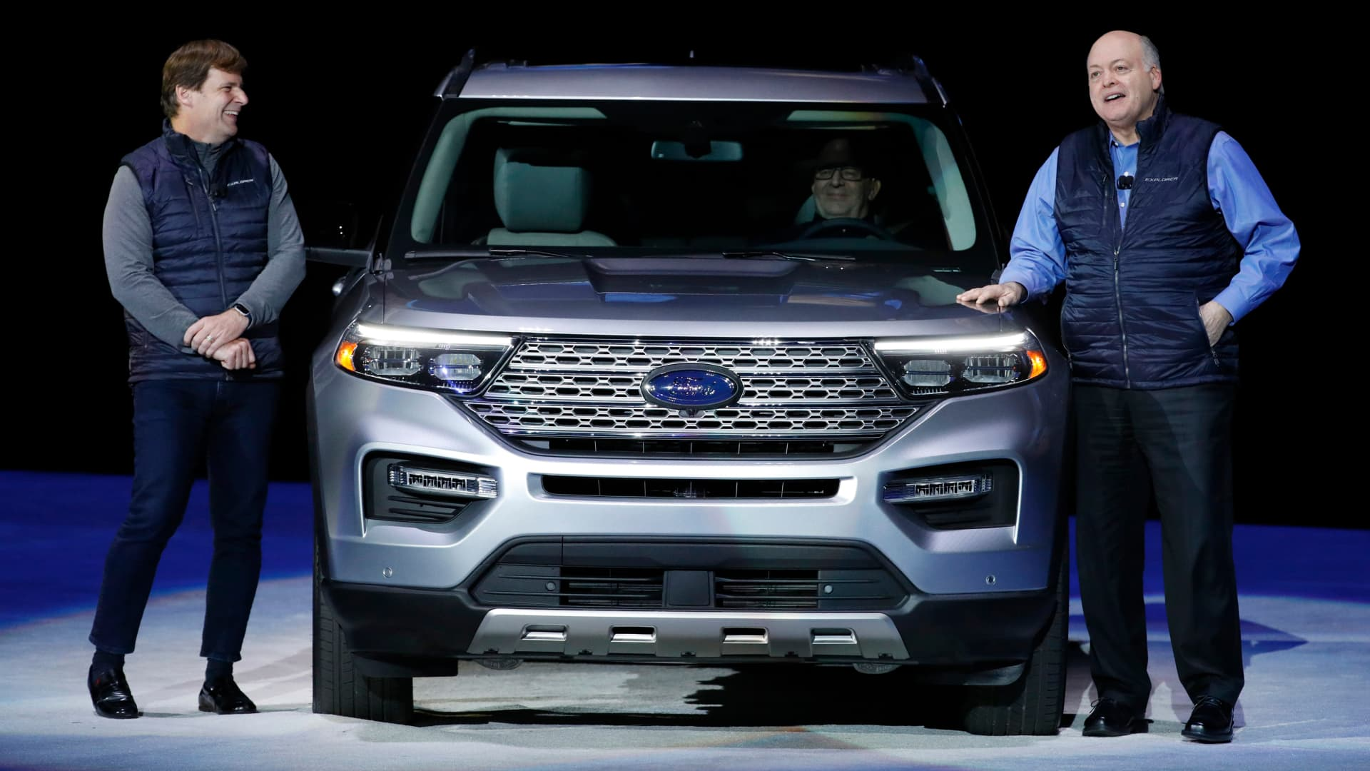 Jim Hackett, president and chief executive officer of Ford Motor Co., right, speaks as Jim Farley, president of global markets, stands next to a 2020 Ford Motor Co. Explorer sport utility vehicle (SUV) during a reveal event in Detroit, Michigan, U.S., on Wednesday, Jan. 9, 2019.