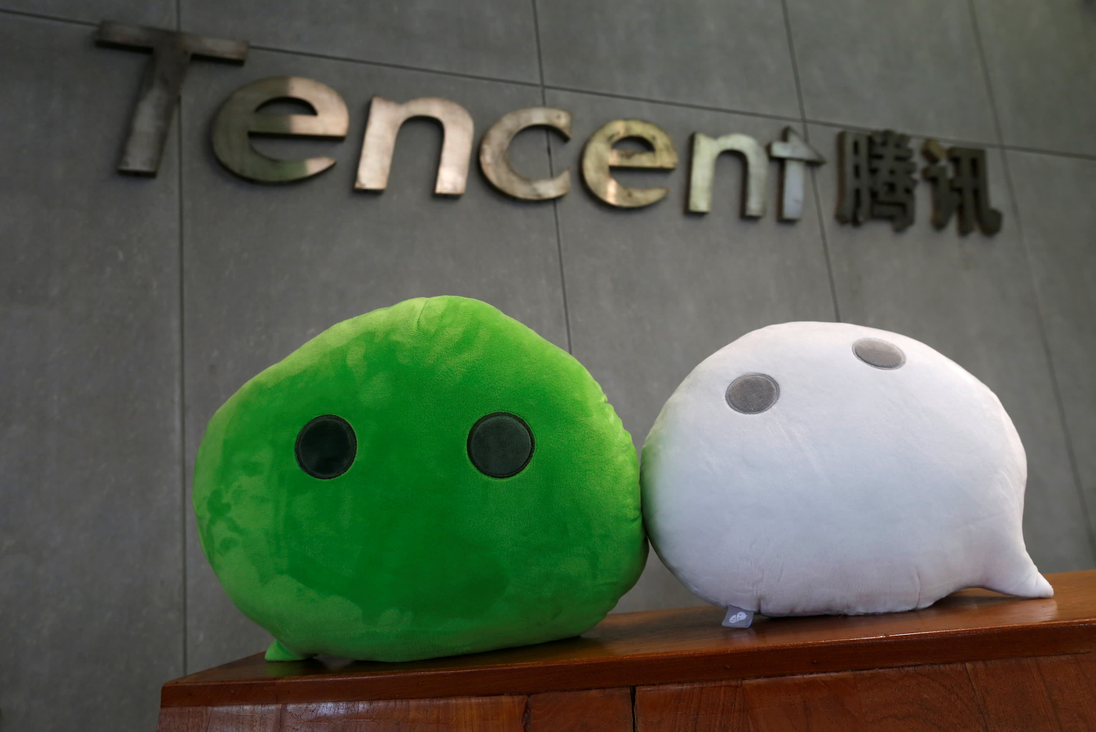 Tencent falls over 5% after hitting an all-time high that pushed it close to a $1 trillion valuation