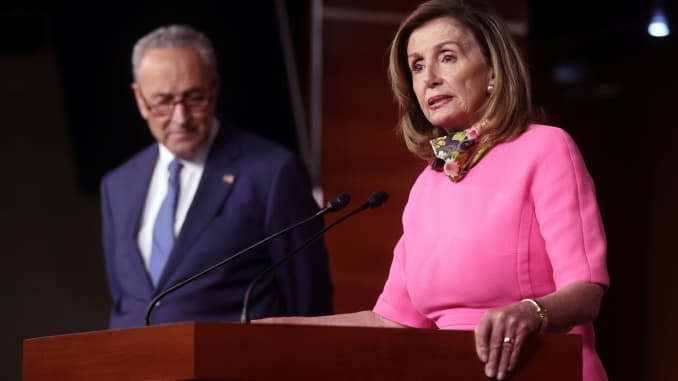 U.S. House Speaker Nancy Pelosi (D-CA), speaks next to Senate Minority Leader Chuck Schumer (D-NY), during a news conference on Capitol Hill in Washington, August 7, 2020.