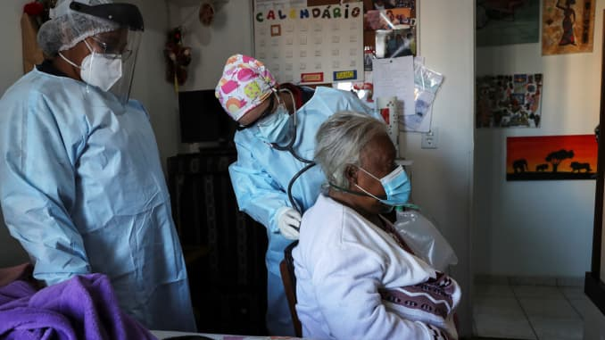 Emergency Rescue Service (SAMU) nurse Belisa Marcelino checks the lungs of Maria Geralda da Silva, 84, who is experiencing breathing difficulty and others symptoms of the coronavirus disease (COVID-19), as preparation is made to transfer the patient to a