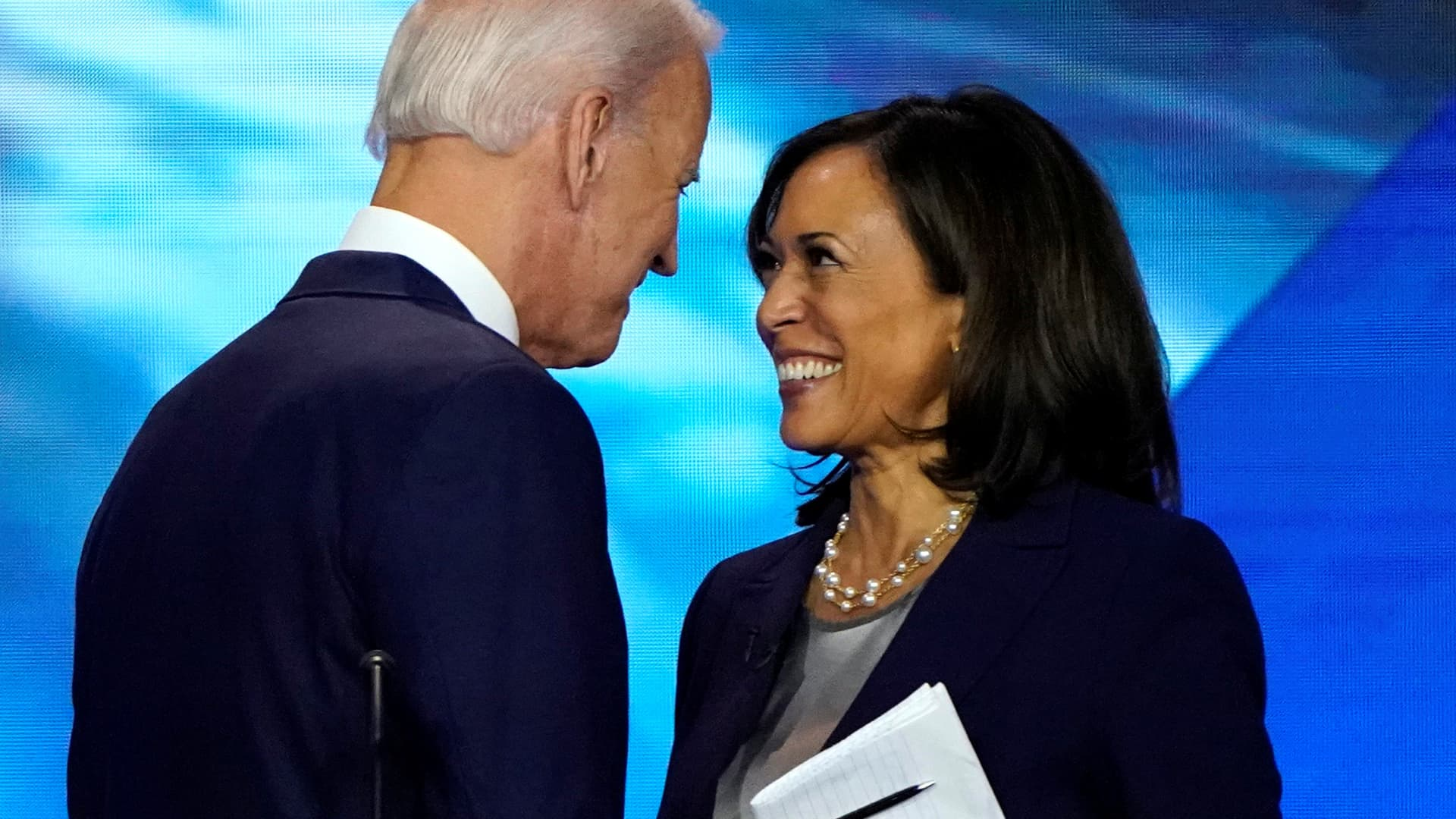 Former Vice President Joe Biden talks with Senator Kamala Harris after the conclusion of the 2020 Democratic U.S. presidential debate in Houston, Texas, September 12, 2019.