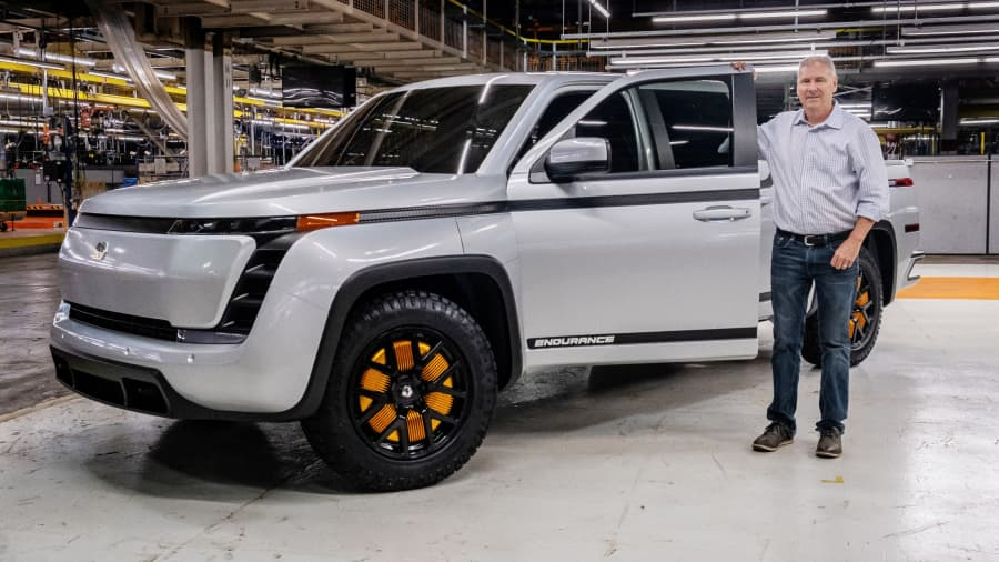 Lordstown Motors Corp Chief Executive Steve Burns poses with a prototype of the electric vehicle start-up's Endurance pickup truck, which it will begin building in the second half of 2021, at the company's plant in Lordstown, Ohio, U.S. June 25, 2020.