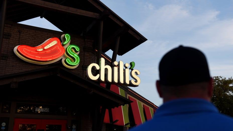 A customer walks towards the entrance of a Brinker International Inc. Chili's Grill & Bar restaurant in San Antonio, Texas.