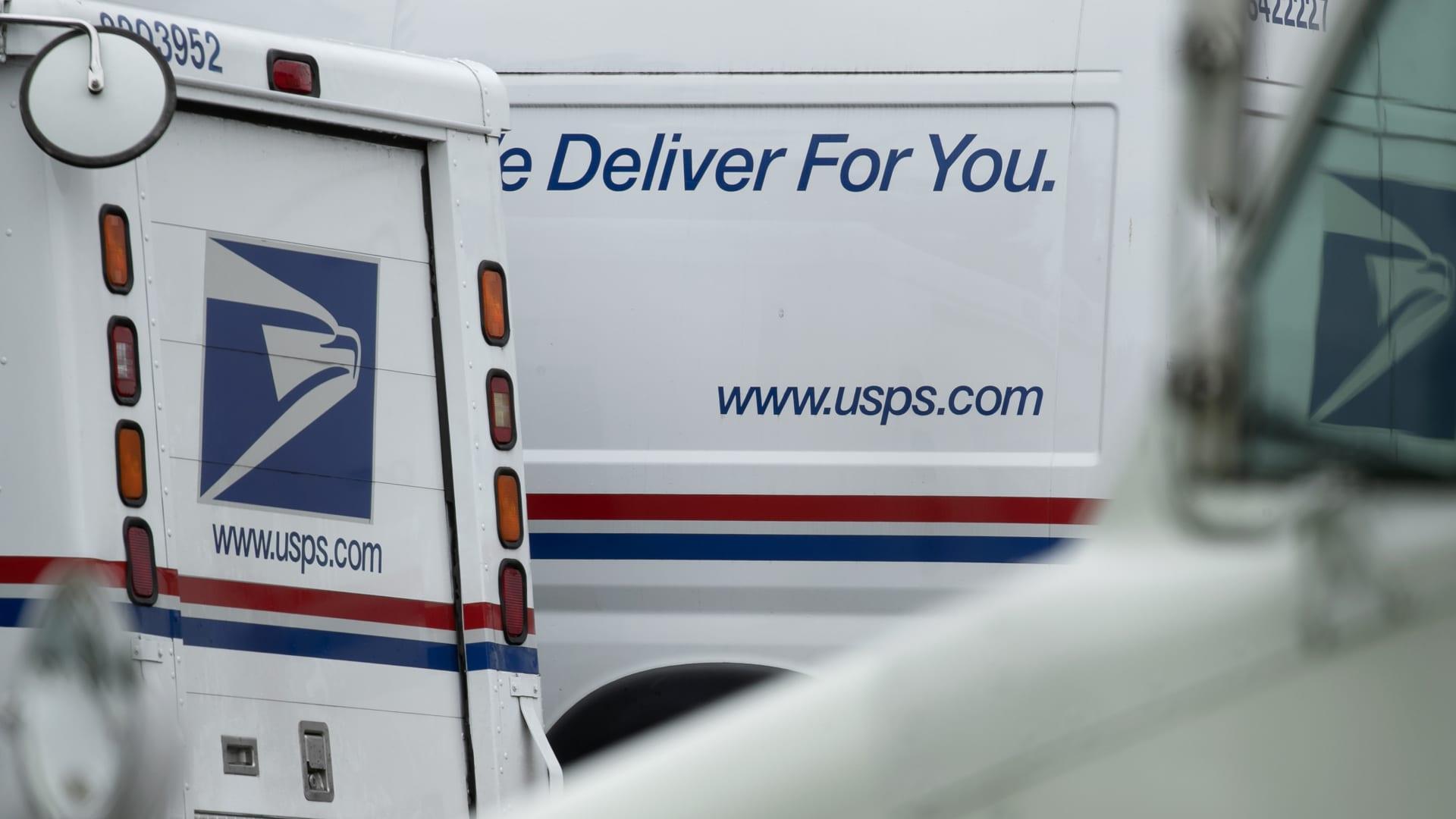 USPS Trucks sit at a U.S. Postal Service (USPS) facility in Elkridge, Maryland, U.S., on Sunday, Aug. 16, 2020.