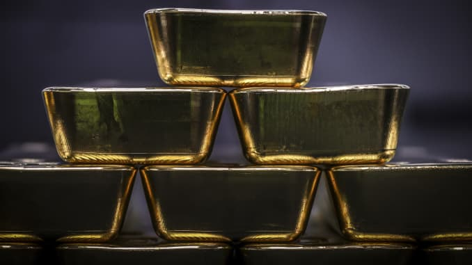 Gold bullion bars are pictured after being inspected and polished at the ABC Refinery in Sydney on August 5, 2020.