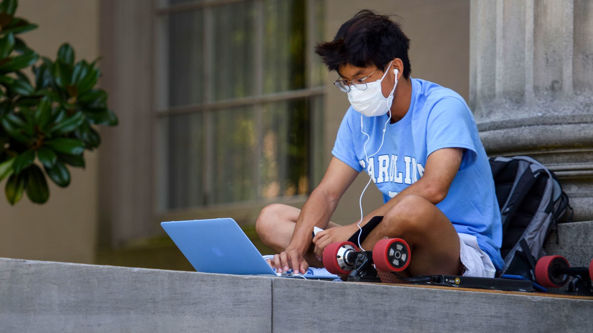 A student outside the closed Wilson Library at the University of North Carolina at Chapel Hill on Aug. 18, 2020.