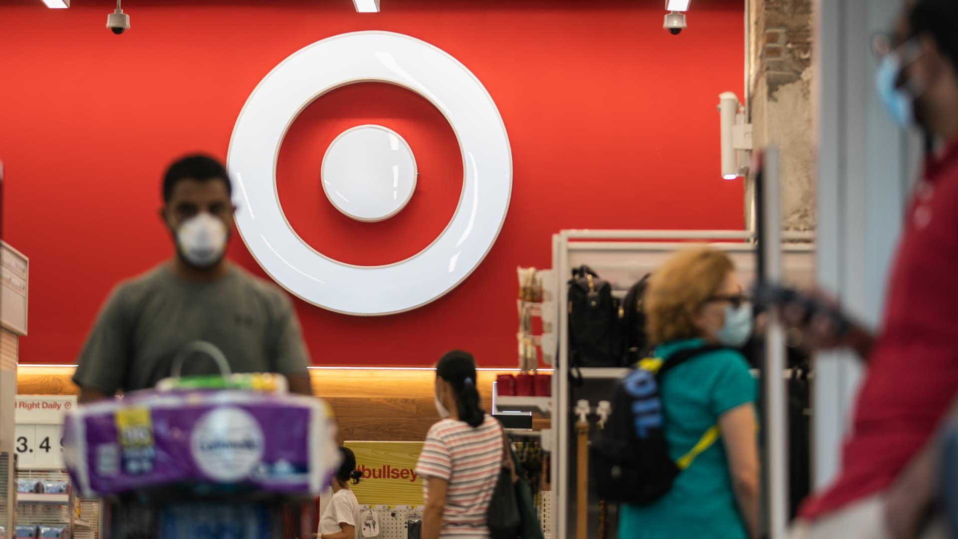 Shoppers wear protective masks inside a Target Corp. store in New York, U.S., on Saturday, Aug. 15, 2020. Target is scheduled to release earnings figures on August 19.