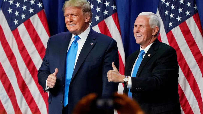 U.S. President Donald Trump and Vice President Mike Pence give a thumbs up after speaking during the first day of the Republican National Convention, in Charlotte, North Carolina, August 24, 2020.