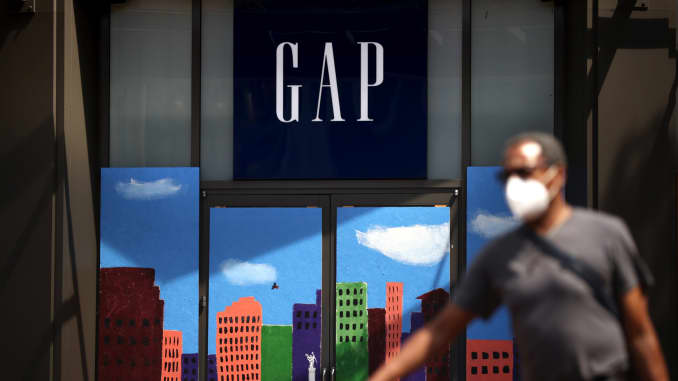 A pedestrian walks by the closed GAP flagship store on August 18, 2020 in San Francisco, California.
