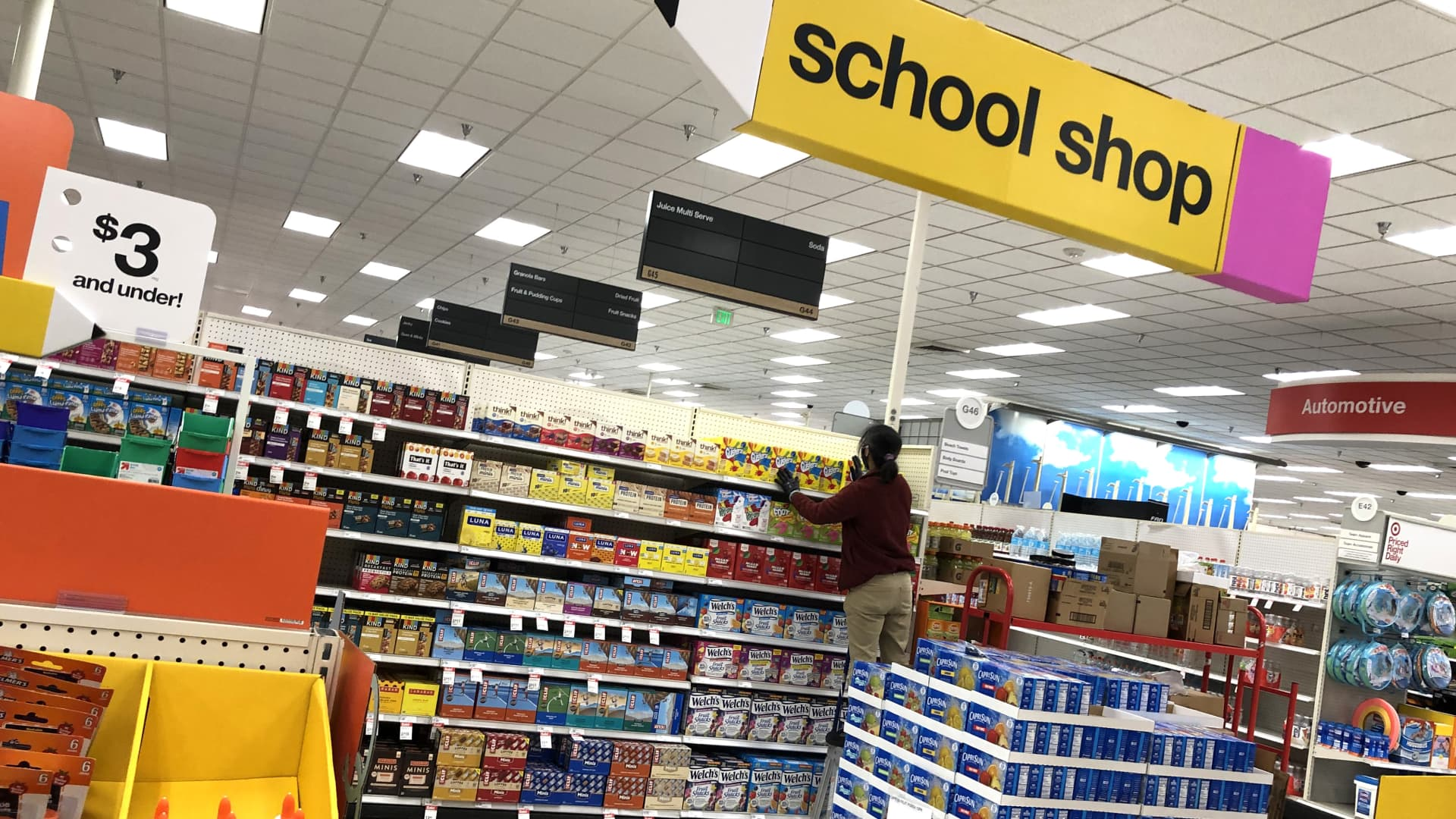 A worker stocks shelves of back-to-school supplies at a Target store on August 03, 2020 in Colma, California.