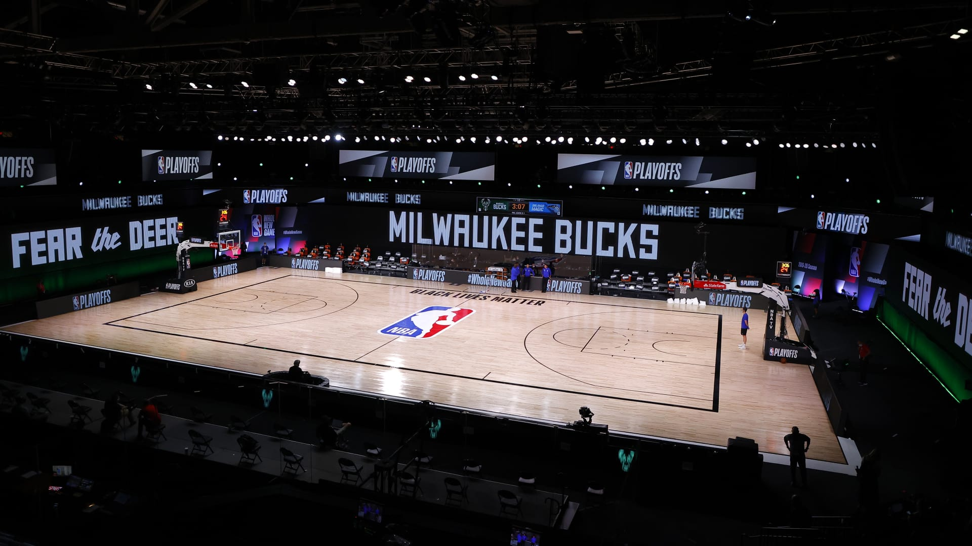 An empty court and bench is shown before the start of a scheduled game between the Milwaukee Bucks and the Orlando Magic for Game Five of the Eastern Conference First Round during the 2020 NBA Playoffs at AdventHealth Arena at ESPN Wide World Of Sports Complex on August 26, 2020 in Lake Buena Vista, Florida.