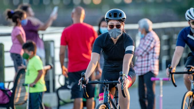 A bicycle rider in Liberty State Park wears a mask during the fourth phase of reopening on August 30, 2020 in Jersey City, New Jersey.