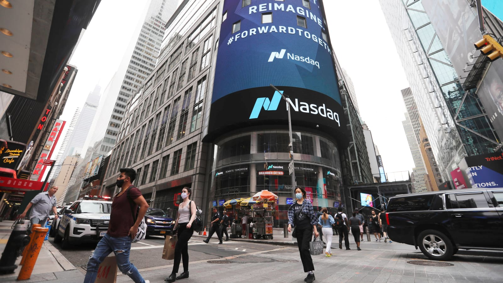 Nasdaq falls 2% as tech sell-off continues, Dow trades off low on Powell