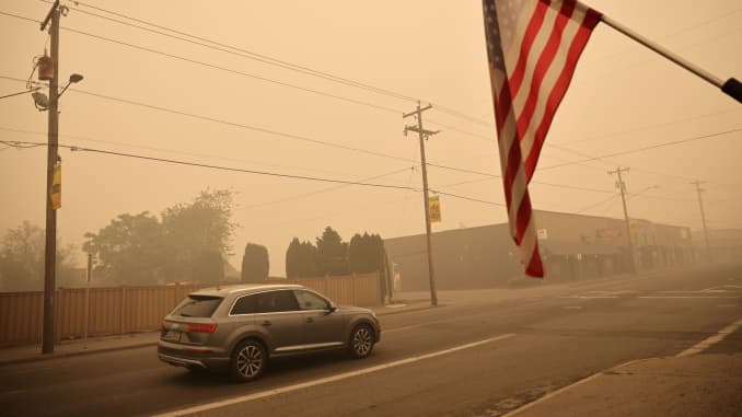 A car is seen around the town where about 10,000 residents were evacuated as the fire continues, in Molalla, Oregon, September 11, 2020.