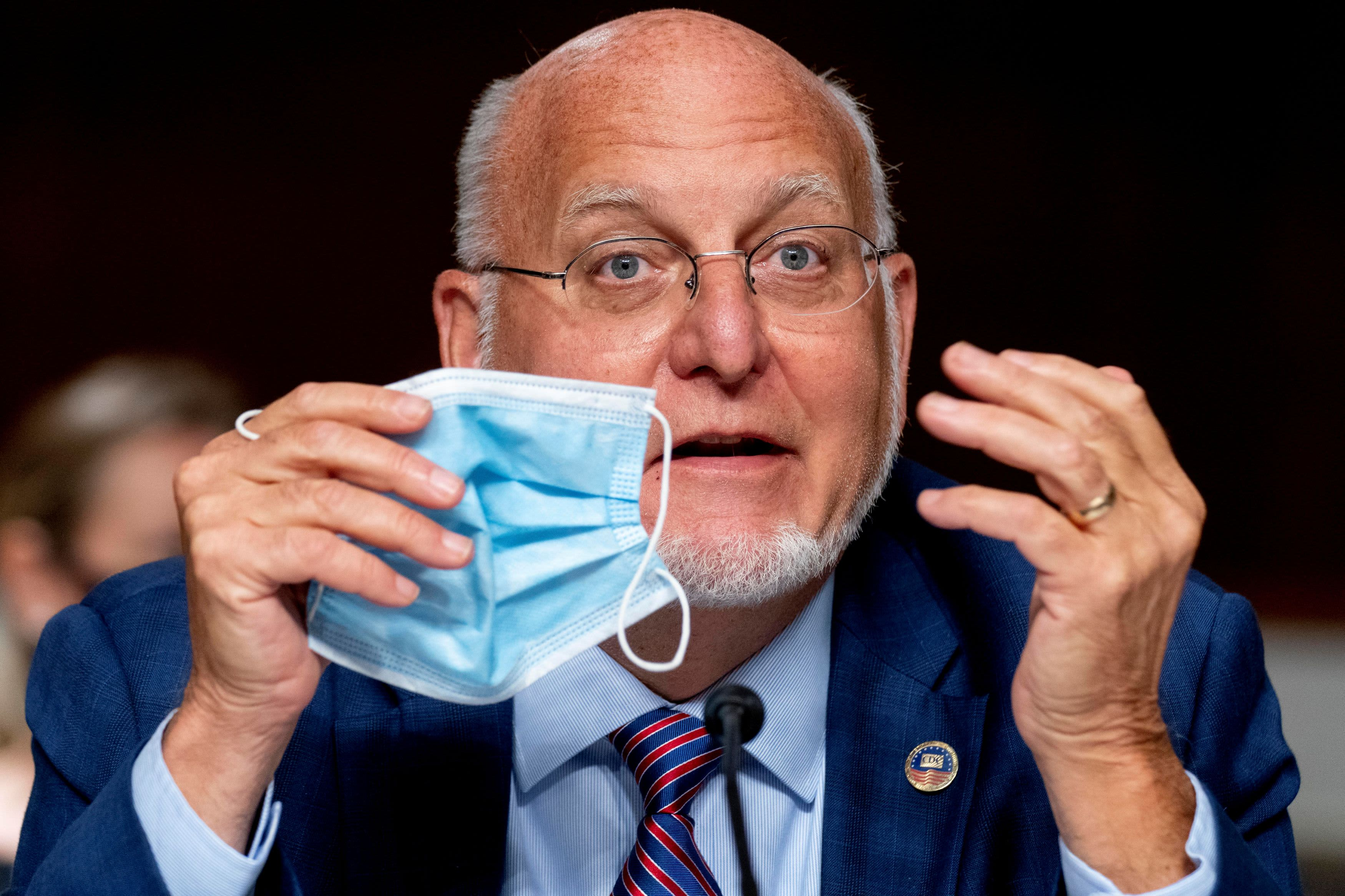 CDC director says face masks may provide more protection than coronavirus vaccine – CNBC