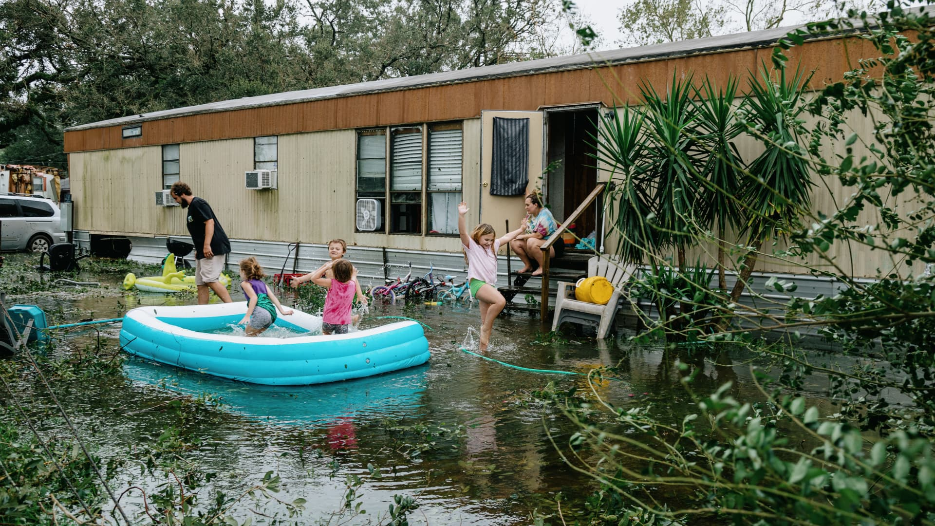 Clinton and Randal Ream with their son Saylor and daughter Nayvie and two neighbors Aubrey Miller and Harmony Morgan at their home in a small trailer park in West Pensacola. The area received a lot of damage after Hurricane Sally came through as a category 2 hurricane in Pensacola, La. on September 16th, 2020.