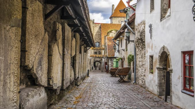 Estonia blends technological advancement with medieval architecture like St. Catherine's Passage in the capital city of Tallinn.