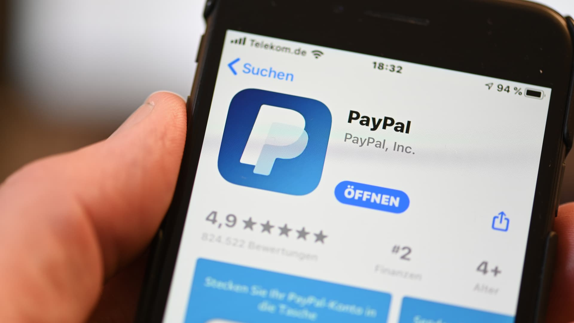 The PayPal application can be seen on a mobile phone.