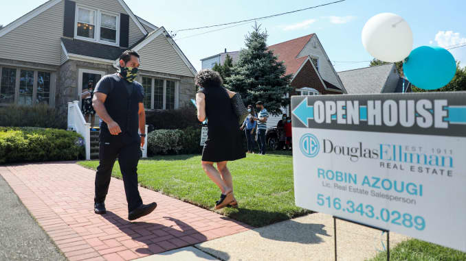 People wait to visit a house for sale in Floral Park, Nassau County, New York.