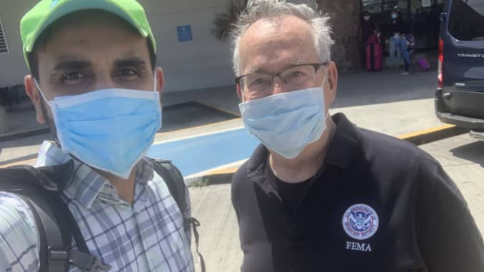 Dr. Salim Saiyed with a fellow front-line worker in the U.S. Virgin Islands.