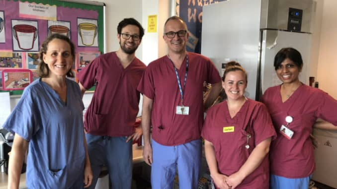 Dr. Ross Breckenridge with colleagues at the hospital.