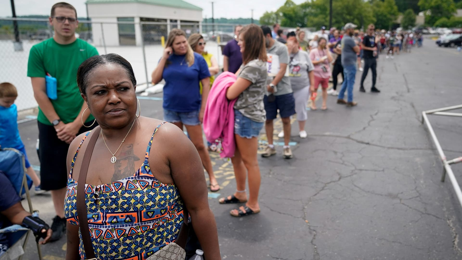 A woman waits in a line outside a temporary unemployment office in Frankfort, Kentucky in June.