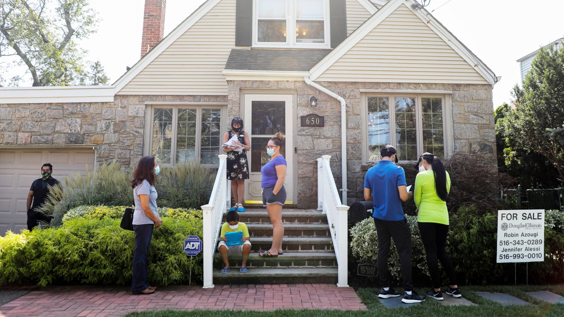 People wait to visit a house for sale in Floral Park, Nassau County, New York, the United States, on Sept. 6, 2020.