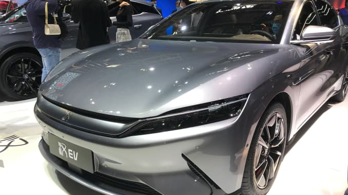 Chinese battery and electric vehicle maker BYD shows off a model of its Han EV series at the 2020 Beijing auto show.